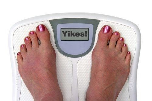 """Feet on a scale reading """"Yikes!"""""""
